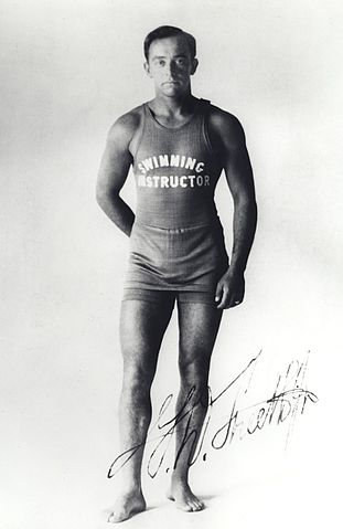 A photo of a man wearing a swimming instructor uniform.